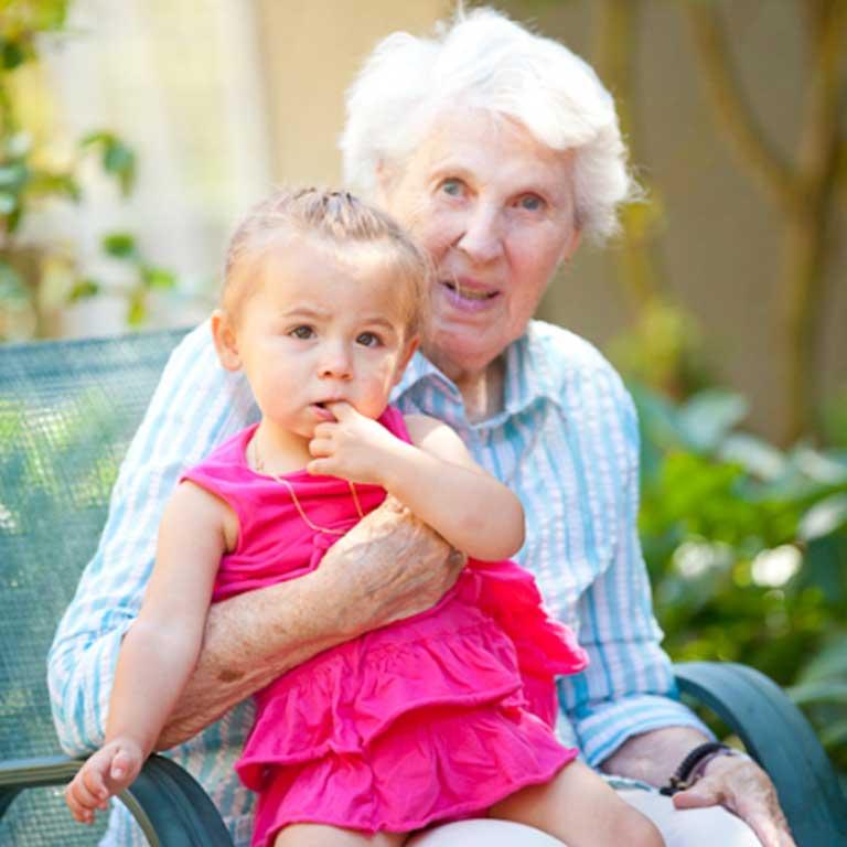VRS Sunnyside Manor Seniors Community Our Mission happy senior resident with family