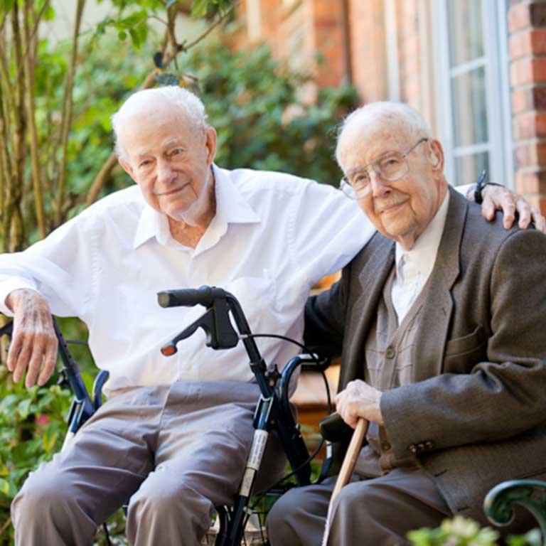 VRS Sunnyside Manor Seniors Community Our Vision happy senior residents sitting in garden