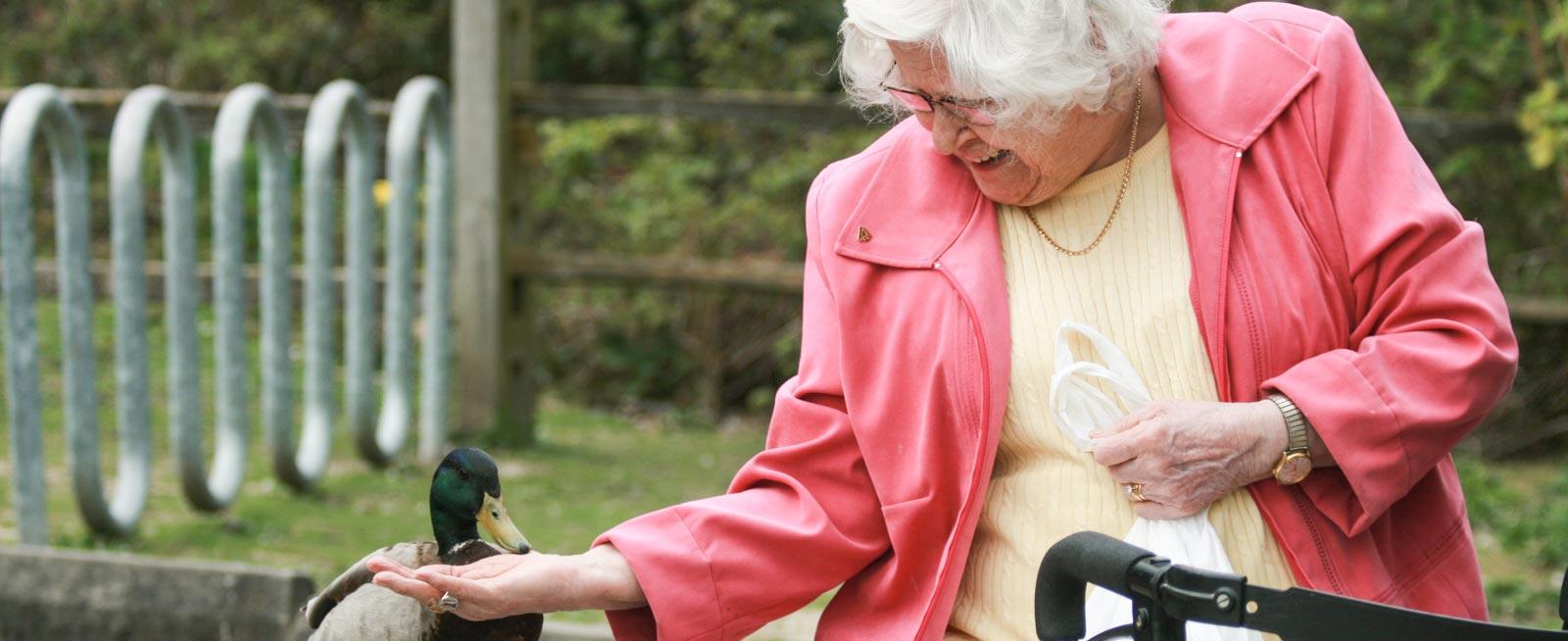 VRS Sunnyside Manor Seniors Community home happy senior resident feeding duck