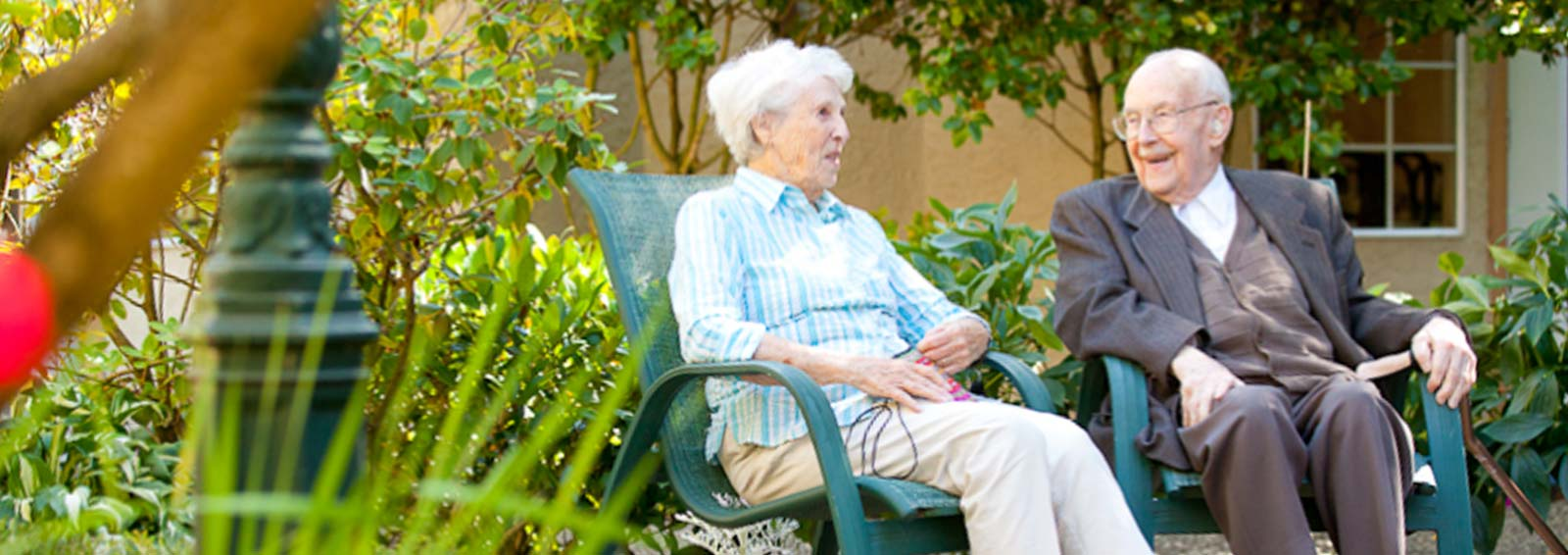 VRS Sunnyside Manor Seniors Community home happy senior residents sitting in garden